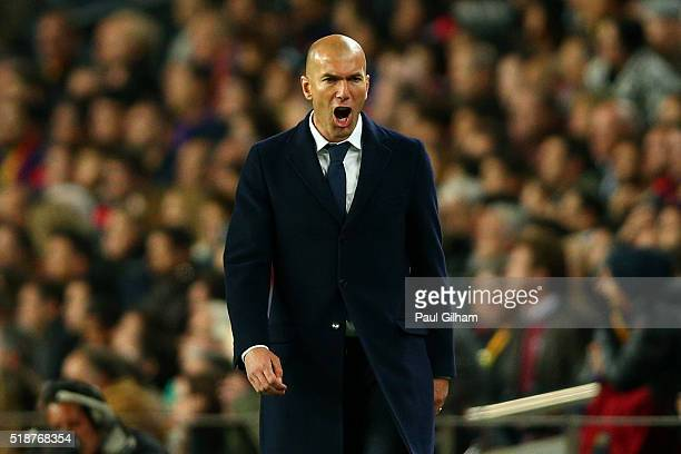 Zinedine Zidane Head Coach of Real Madrid CF reacts on the touchline during the La Liga match between FC Barcelona and Real Madrid CF at Camp Nou on...