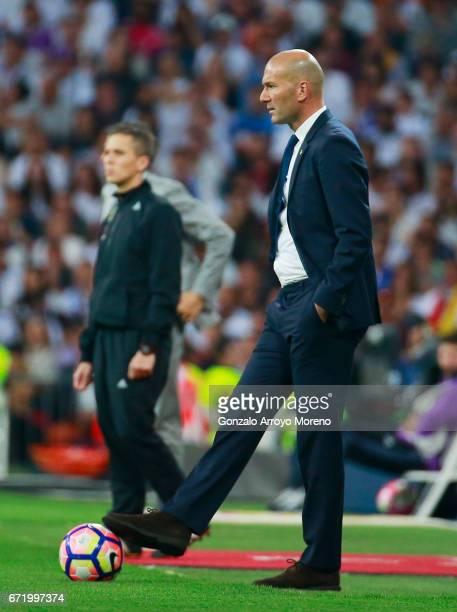 Zinedine Zidane head coach of Real Madrid controls the ball during the La Liga match between Real Madrid CF and FC Barcelona at Estadio Bernabeu on...
