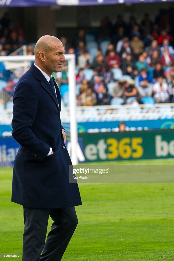 Zinedine Zidane, head coach of real Madrid, reacts during the Spanish league football match between Real Sociedad and Real Madrid at the Anoeta Stadium in San Sebastian on April 30, 2016