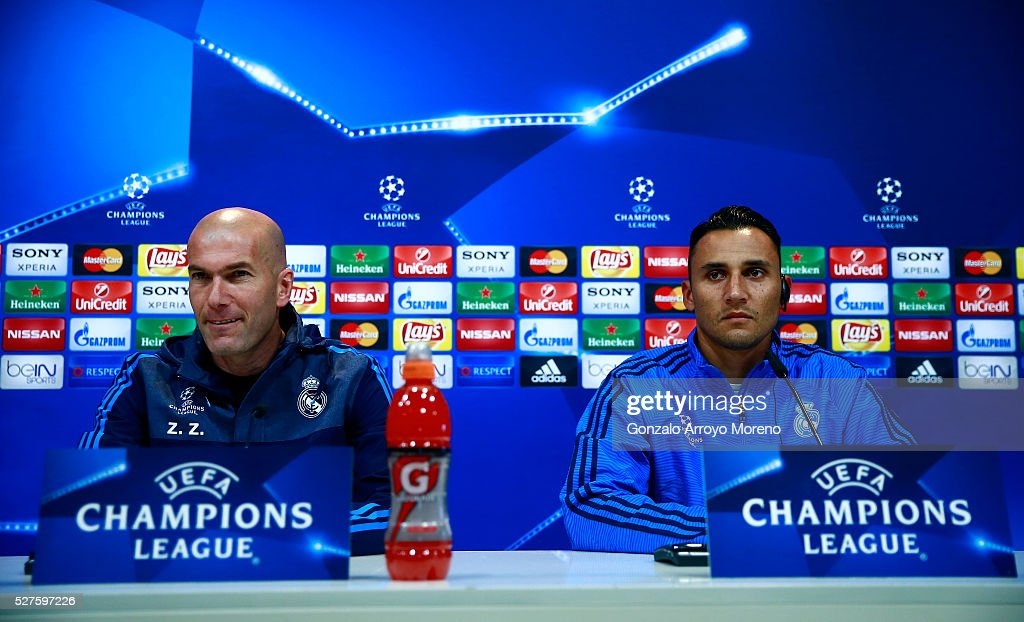 Zinedine Zidane, Manager of Real Madrid and <a gi-track='captionPersonalityLinkClicked' href=/galleries/search?phrase=Keylor+Navas&family=editorial&specificpeople=2097517 ng-click='$event.stopPropagation()'>Keylor Navas</a> of Real Madrid face the media during a press conference ahead of the UEFA Champions League Semi Final Second Leg between Real Madrid and Manchester City at Valdebebas training ground on May 3, 2016 in Madrid, Spain.