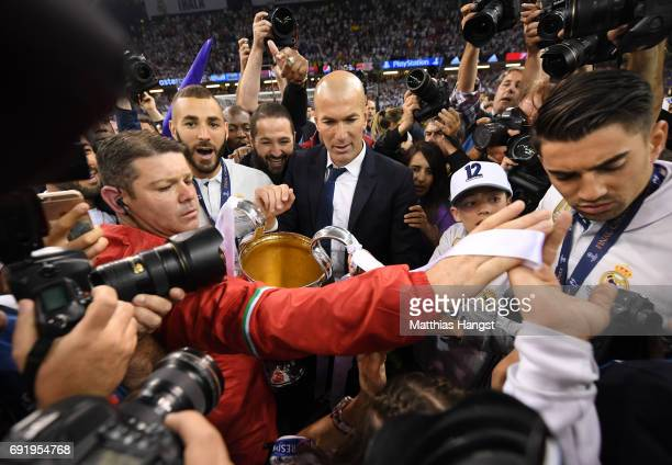 Zinedine Zidane Manager of Real Madrid attempts to leave the pitch after the UEFA Champions League Final between Juventus and Real Madrid at National...