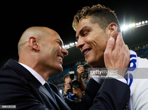 Zinedine Zidane Manager of Real Madrid celebrates with Cristiano Ronaldo after being crowned champions following the La Liga match between Malaga and...