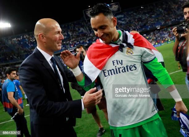Zinedine Zidane Manager of Real Madrid celebrates with Keylor Navas of Real Madrid following the La Liga match between Malaga and Real Madrid at La...