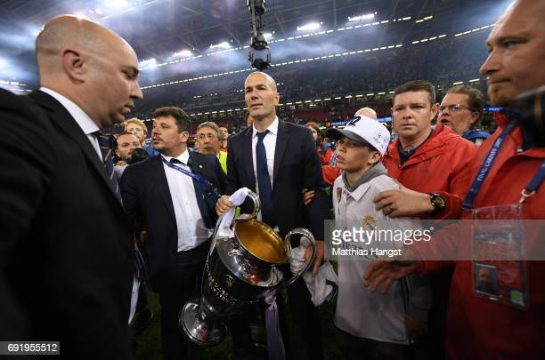 Zinedine Zidane Manager of Real Madrid celebrates with The Champions League trophy after the UEFA Champions League Final between Juventus and Real...
