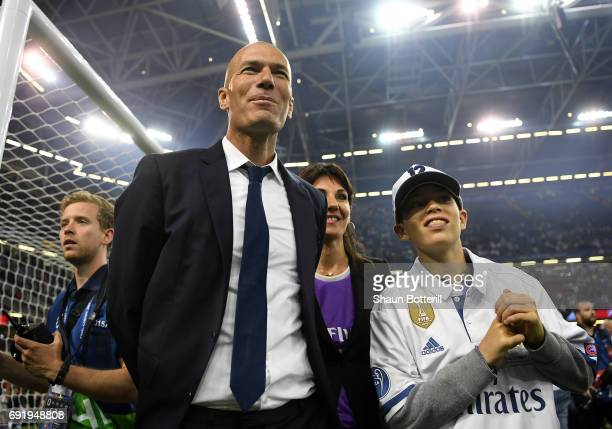 Zinedine Zidane Manager of Real Madrid celerbrates with his wife Véronique Fernández after the UEFA Champions League Final between Juventus and Real...