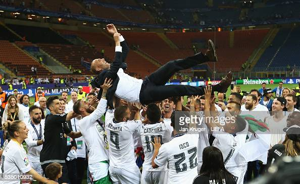 Zinedine Zidane manager of Real Madrid is thrown in the air by the players after the UEFA Champions League Final between Real Madrid and Club...