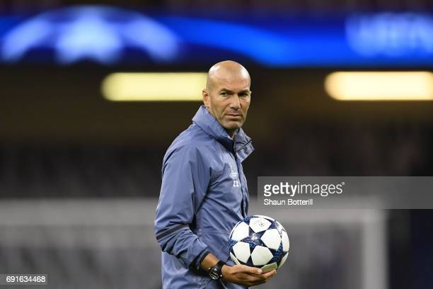 Zinedine Zidane Manager of Real Madrid looks on during a Real Madrid training session prior to the UEFA Champions League Final between Juventus and...