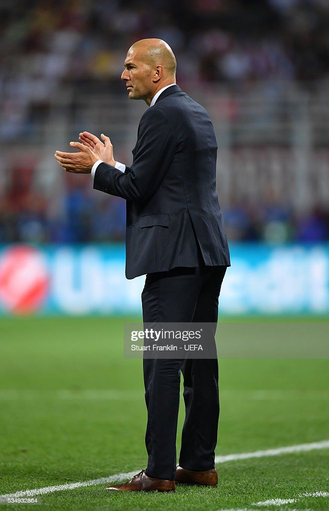 <a gi-track='captionPersonalityLinkClicked' href=/galleries/search?phrase=Zinedine+Zidane&family=editorial&specificpeople=172012 ng-click='$event.stopPropagation()'>Zinedine Zidane</a> manager of Real Madrid looks on during the UEFA Champions League Final between Real Madrid and Club Atletico de Madrid at Stadio Giuseppe Meazza on May 28, 2016 in Milan, Italy..