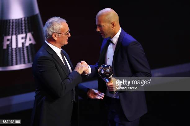 Zinedine Zidane of France and Real Madrid CF is presented The best Fifa men's coach award and is congratulated by Claudio Ranieri during The Best...