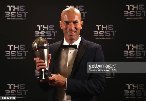 Zinedine Zidane of France and Real Madrid CF poses with the Best Men's Coach Award during The Best FIFA Football Awards at The London Palladium on...