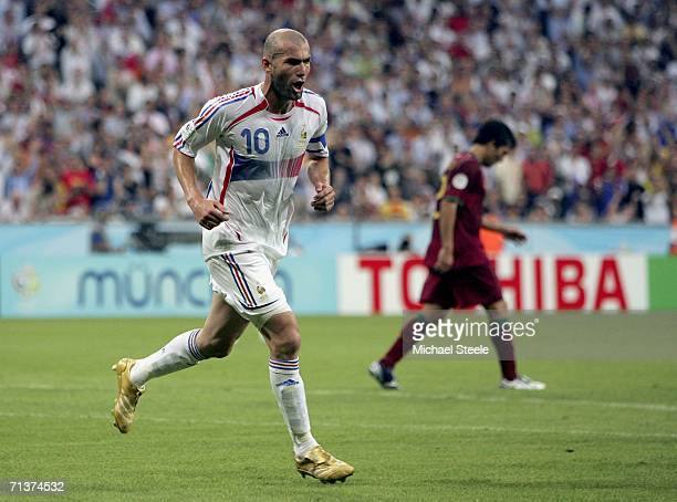 Zinedine Zidane of France celebrates after scoring the opening goal from the penalty spot during the FIFA World Cup Germany 2006 Semifinal match...