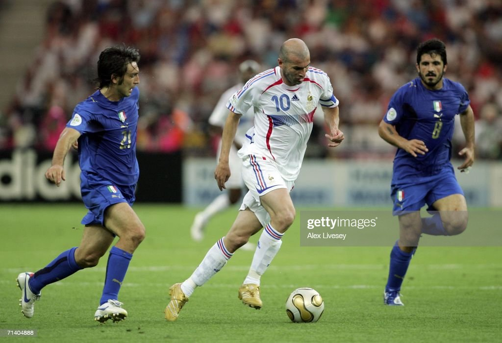 Zinedine Zidane (C) of France goes past Andrea Pirlo (L) and Gennaro Gattuso (R) of Italy during the FIFA World Cup Germany 2006 Final match between Italy and France at the Olympic Stadium on July 9, 2006 in Berlin, Germany.