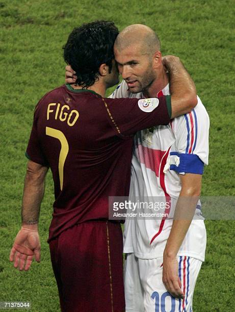 Zinedine Zidane of France is hugged by Luis Figo of Portugal following France's 10 victroy during the FIFA World Cup Germany 2006 Semifinal match...