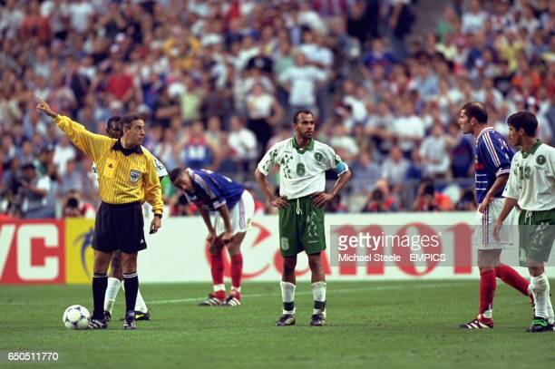 Zinedine Zidane of France is sent off by referee Arturo Brizio Carter