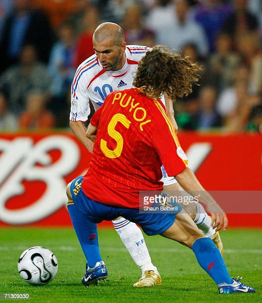Zinedine Zidane of France looks for a way past Carlos Puyol of Spain during the FIFA World Cup Germany 2006 Round of 16 match between Spain and...