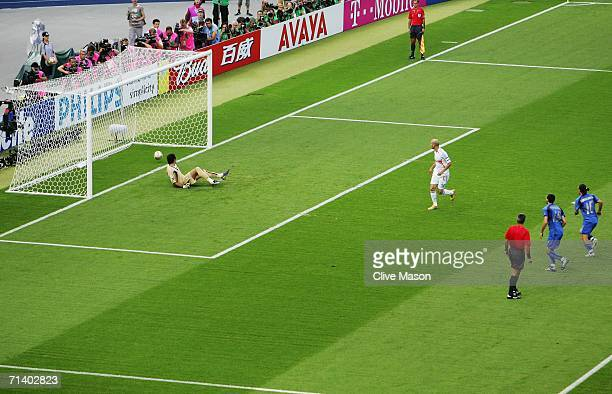 Zinedine Zidane of France scores the opening goal from the penalty spot past Goalkeeper Gianluigi Buffon of Italy during the FIFA World Cup Germany...