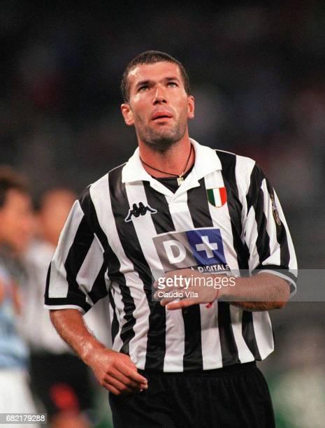 Zinedine Zidane of Juventus in action during the 'SIVIO BERLUSCONI CUP' match between MILAN and JUVENTUS played at Giuseppe Meazza stadium in Milan...