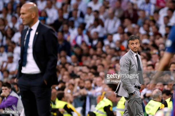 Zinedine Zidane of Real Madrid and Luis Enrique of FC Barcelona looks on during the La Liga match between Real Madrid CF and FC Barcelona at the...