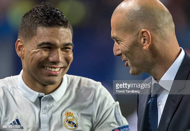 Zinedine Zidane of Real Madrid celebrate victory with Carlos Henrique Casimiro after theUEFA Super Cup match between Real Madrid and Sevilla at the...