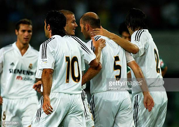 Zinedine Zidane of Real Madrid celebrates the first goal with his teammates Michel Salgado David Beckham and Luis Figo during the preseason friendly...