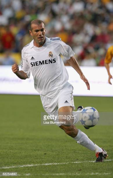 Zinedine Zidane of Real Madrid dribbles against the defense of the Los Angeles Galaxy during the game at the Home Depot Center on July 18 2005 in...