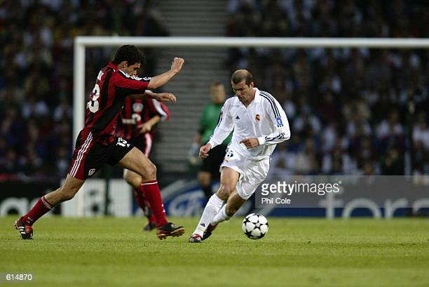 Zinedine Zidane of Real Madrid goes past Michael Ballack of Bayer Leverkusen during the UEFA Champions League Final played at Hampden Park in Glasgow...