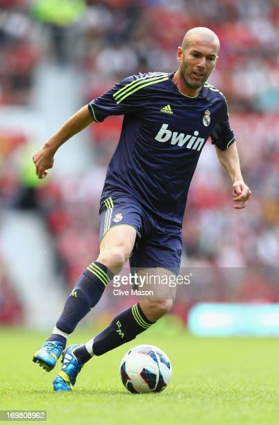 Zinedine Zidane of Real Madrid in action during the match between Manchester United Legends and Real Madrid Legends at Old Trafford on June 2 2013 in...