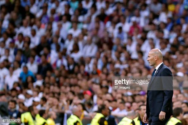 Zinedine Zidane of Real Madrid looks on during the La Liga match between Real Madrid CF and FC Barcelona at the Santiago Bernabeu stadium on April 23...