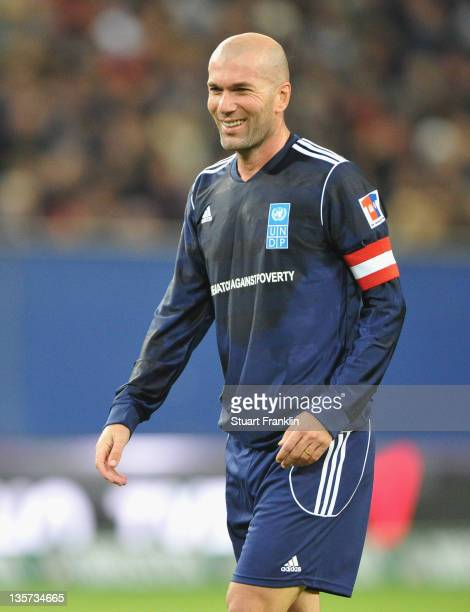Zinedine Zidane of the friends team looks happy during the charity Match Against Poverty between HSV Allstars v Ronaldo Zidane Friends at the Imtech...