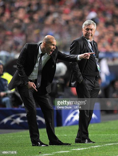 Zinedine Zidane shouts instructions as Real Madrid coach Carlo Ancelotti looks on during the UEFA Champions League Final between Real Madrid CF and...
