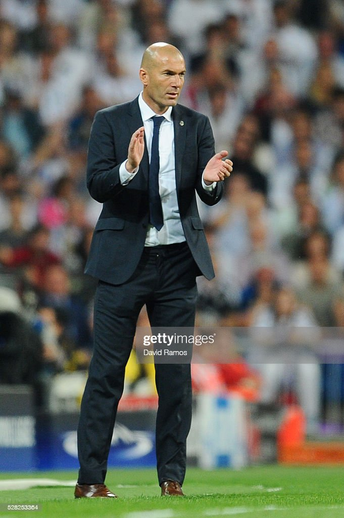 Zinedine Zidane the head coach of Real Madrid looks on during the UEFA Champions League semi final, second leg match between Real Madrid and Manchester City FC at Estadio Santiago Bernabeu on May 4, 2016 in Madrid, Spain.