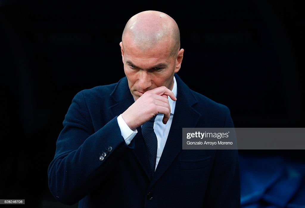 Zinedine Zidane the head coach of Real Madrid reacts during the UEFA Champions League semi final, second leg match between Real Madrid and Manchester City FC at Estadio Santiago Bernabeu on May 4, 2016 in Madrid, Spain.