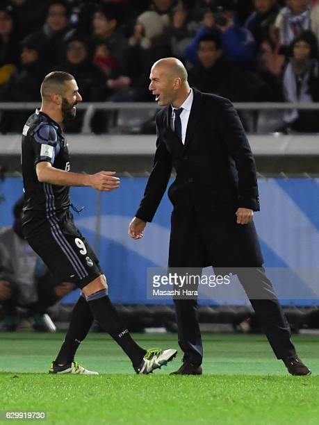 Zinedine Zidanecoach and Karim Benzema of Real Madrid celebrate the first goal during the FIFA Club World Cup Semi Final between Club America and...