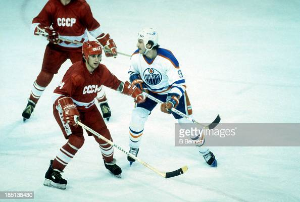 Zinetula Bilyaletdinov of the USSR defends against Glenn Anderson of the Edmonton Oilers during the 198283 Super Series on December 28 1982 at the...