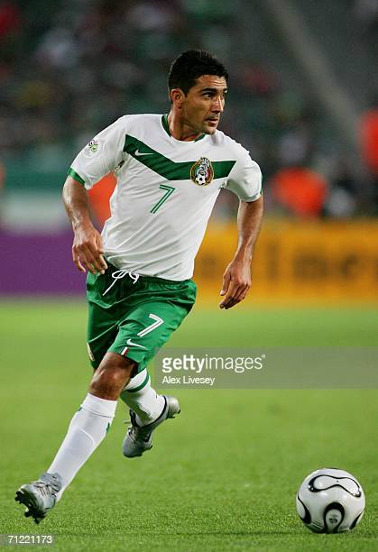 Zinha of Mexico looks upfield for options during the FIFA World Cup Germany 2006 Group D match between Mexico and Angola played at the Stadium...