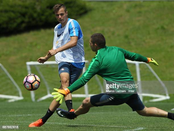 Zinho Vanheusden is challenged by Juan Pablo Carrizo during the FC Internazionale training session at the club's training ground Suning Training...