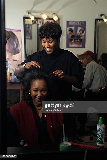Zinzi Mandela daughter of Nelson Mandela gets her hair styled by Alece Cooper for her father's presidential inauguration after South Africa's first...