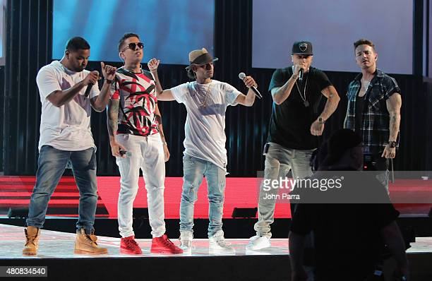 Zion De La Ghetto Arcangel Nicky Jam and J Balvin perform onstage during Univision's Premios Juventud 2015 rehearsal at Bank United Center on July 15...