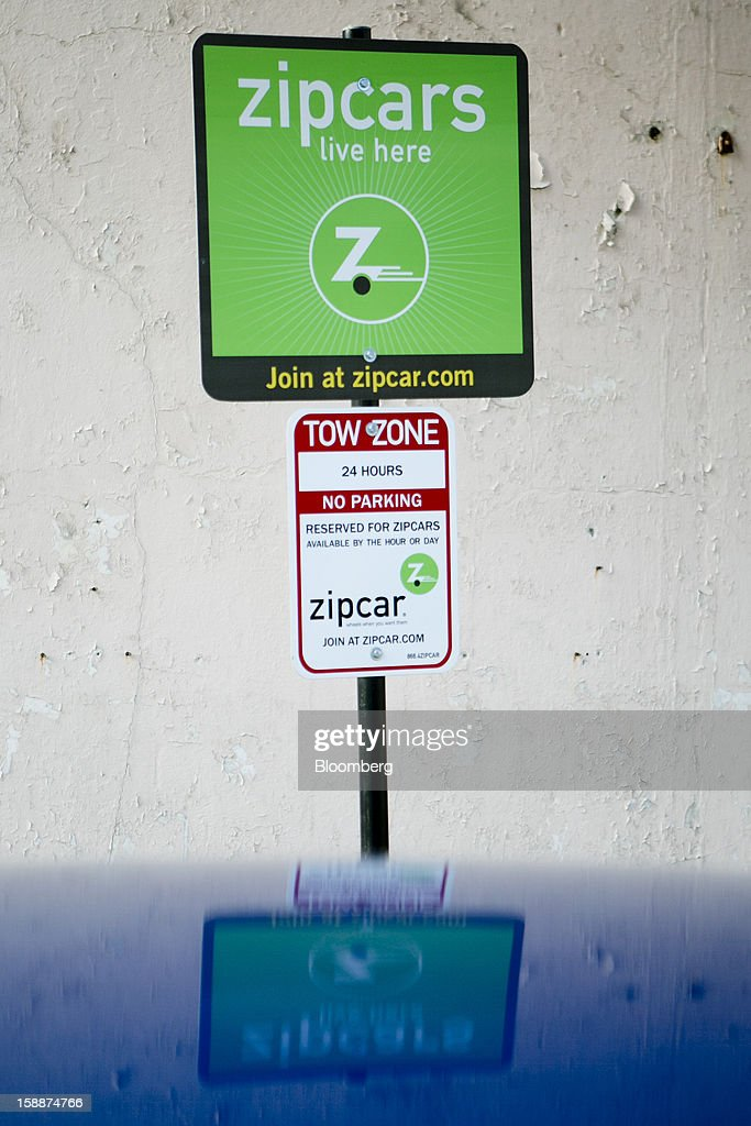 A Zipcar Inc. sign stands in one of the company's parking spaces in Washington, D.C., U.S., on Wednesday, Jan. 2, 2013. Avis Budget Group Inc., once a skeptic about car sharing services, agreed to buy short-term rental pioneer Zipcar for $491 million, signaling a shift in the industry to embracing drivers who don't want to own cars. Photographer: Andrew Harrer/Bloomberg via Getty Images