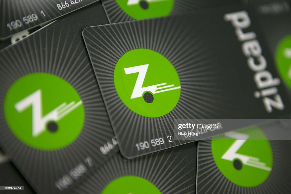 Zipcar Inc. Zipcard membership cards are arranged for a photograph in Washington, D.C., U.S., on Wednesday, Jan. 2, 2013. Avis Budget Group Inc., once a skeptic about car sharing services, agreed to buy short-term rental pioneer Zipcar for $491 million, signaling a shift in the industry to embracing drivers who don't want to own cars. Photographer: Andrew Harrer/Bloomberg via Getty Images
