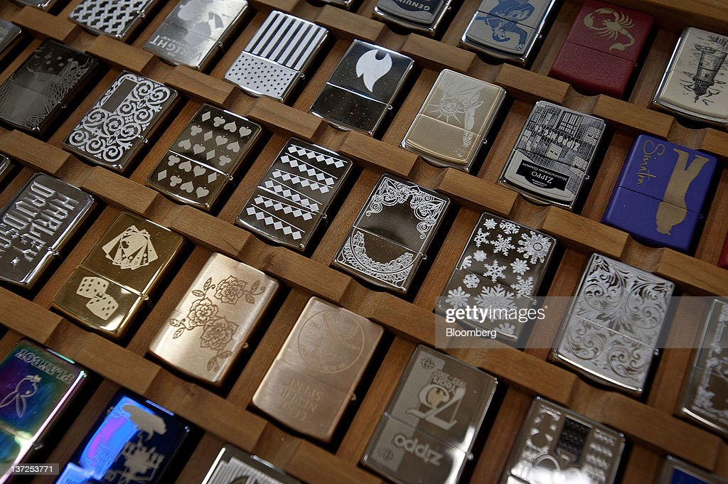 Zippo Manufacturing Co. lighters are displayed for a photograph at the company's plant in Bradford, Pennsylvania, U.S., on Tuesday, Jan. 17, 2012. The U.S. Federal Reserve is scheduled to release monthly industrial production figures on Jan. 18. Photographer: Paul Taggart/Bloomberg via Getty Images