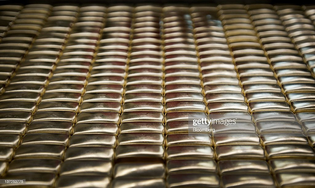 Zippo Manufacturing Co. lighters sit on the production line at the company's plant in Bradford, Pennsylvania, U.S., on Tuesday, Jan. 17, 2012. The U.S. Federal Reserve is scheduled to release monthly industrial production figures on Jan. 18. Photographer: Paul Taggart/Bloomberg via Getty Images