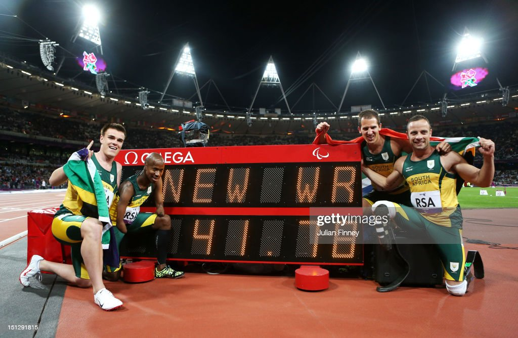 Zivan Smith, Samkelo Radebe, Arnu Fourie and <a gi-track='captionPersonalityLinkClicked' href=/galleries/search?phrase=Oscar+Pistorius&family=editorial&specificpeople=224406 ng-click='$event.stopPropagation()'>Oscar Pistorius</a> of South Africa celebrate winning gold and setting a new world record after the Men's 4x100m relay T42/T46 Final on day 7 of the London 2012 Paralympic Games at Olympic Stadium on September 5, 2012 in London, England.