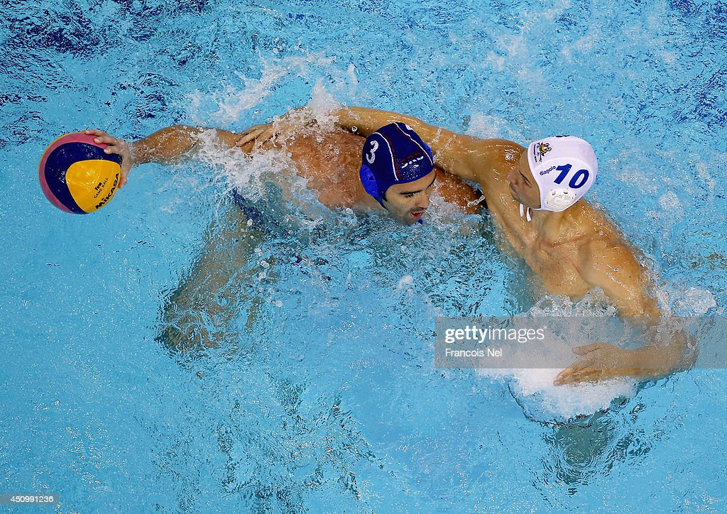 Zivko Gocic of Serbia controls the ball against Denes Varga of Hungary during the Fina Men's Water Polo World League Super Final match between Hugary and Serbia at the Hamdan Sports Complex on June 21, 2014 in Dubai, United Arab Emirates.
