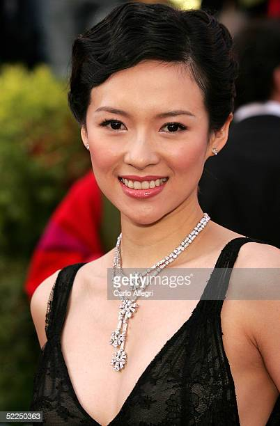 Ziyi Zhang arrives on the red carpet wearing jewelry by Bvlgari at the 77th Annual Academy Awards at the Kodak Theater on February 27 2005 in...
