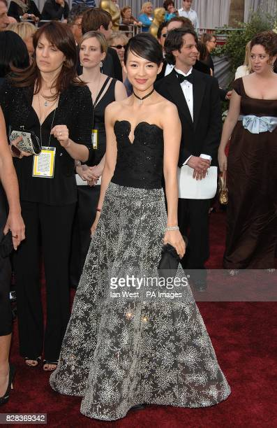 Ziyi Zhang wearing a dress by Giorgio Armani arrives on the red carpet