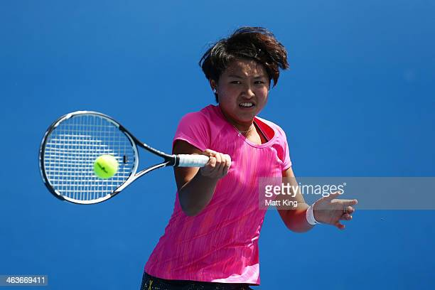 Ziyue Sun of China plays a backhand in her first round junior girls' match against Linda Huang of Australia during the 2014 Australian Open Junior...