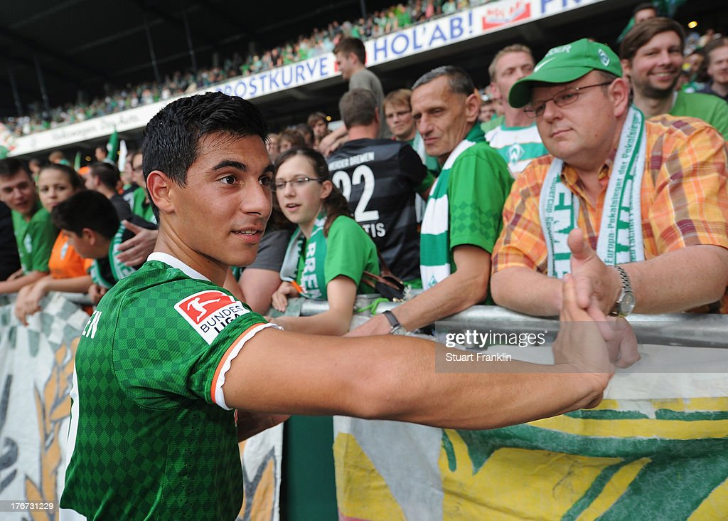 zkan Yildirim of Bremen celebrates with fans after the Bundesliga match between Werder Bremen and FC Augsburg at Weserstadion on August 17, 2013 in Bremen, Germany.