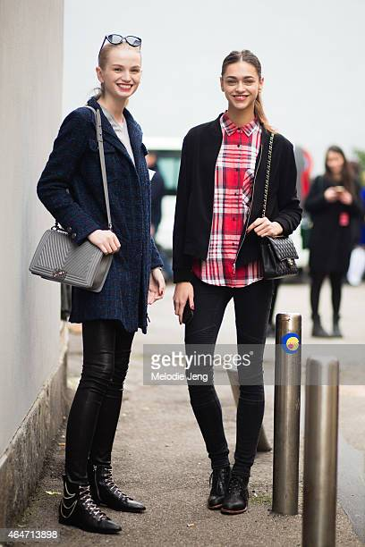 Zlata Semenko and Zhenya Katava exit the Emporio Armani show with Chanel purses on February 27 2015 in Milan Italy