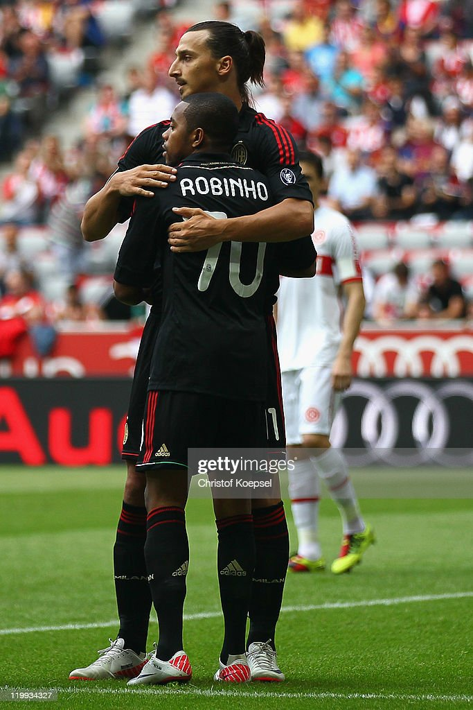 Zlatan Bajramovic celebrates the first goal with Robinho of Milan during the Audi Cup third place match between AC Milan and International De Porto...